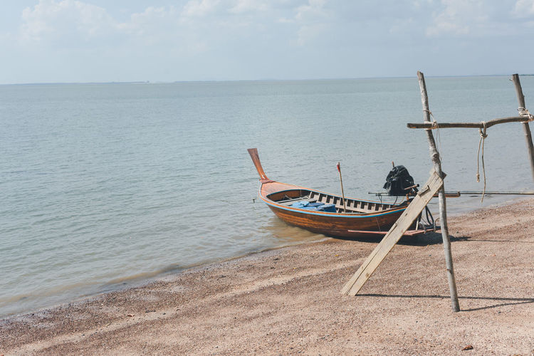 Wooden boat moored on shore