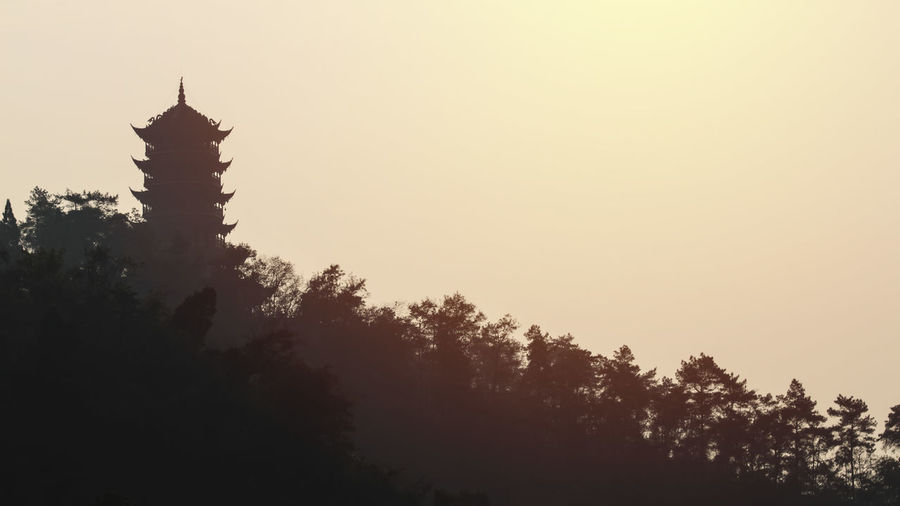 Chinese pagoda at sunset Chengdu China ASIA Pagoda Temple Religion Faith Sky Architecture Built Structure Growth Clear Sky Tree No People Copy Space Plant Silhouette