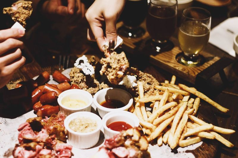 #food Food And Drink Hand Human Hand Table Real People Human Body Part Business Lifestyles Restaurant Eating Drink
