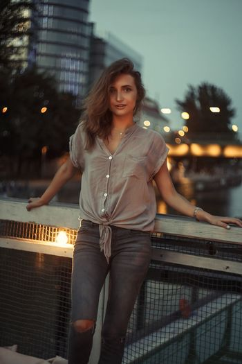 Young Adult Night Illuminated Young Women City Outdoors One Person Building Exterior Built Structure Architecture Dusk Focus On Foreground Front View Lifestyles Portrait Leisure Activity Beautiful Woman Real People Smiling Happiness