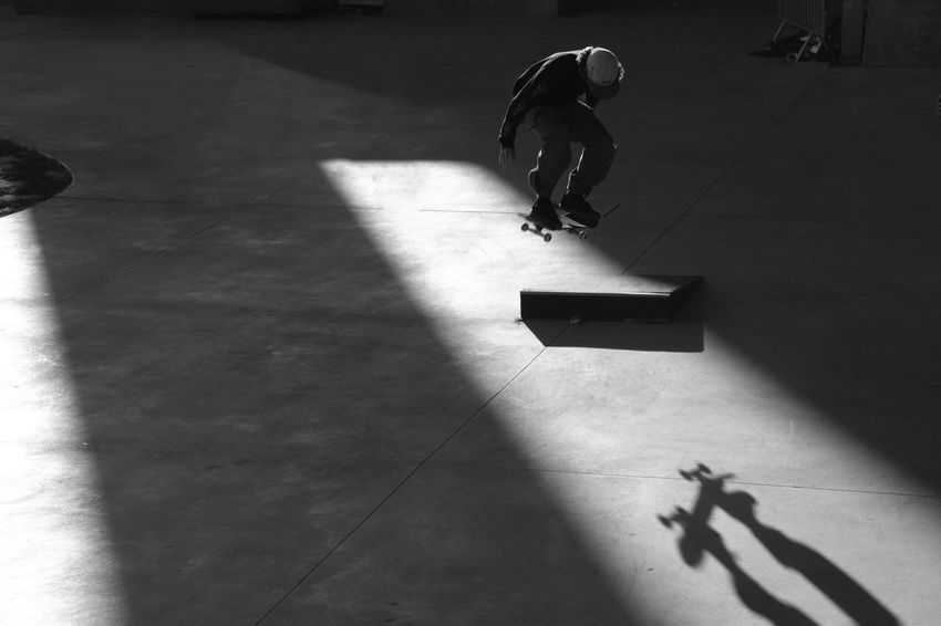 """"""" In the air """" Shades Of Grey Shadows & Lights Skateboarding Adult B&w Blackandwhite Childhood Day Full Length High Angle View Indoors  Leisure Activity Lifestyles Men One Person People Playing Real People Shadow Skate Skill  Sport Sports Streetphotography Sunlight The Street Photographer - 2018 EyeEm Awards"""
