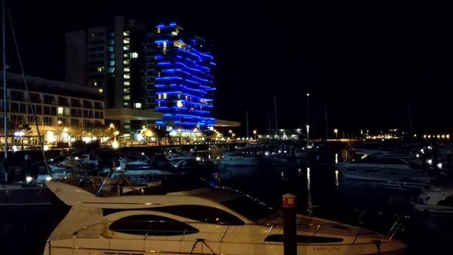 Reflection Night Architecture Illuminated Travel Destinations River Travel Building Exterior Water Built Structure Nautical Vessel Skyscraper Modern Urban Skyline Yacht Outdoors Cityscape Sky Troia Portugal
