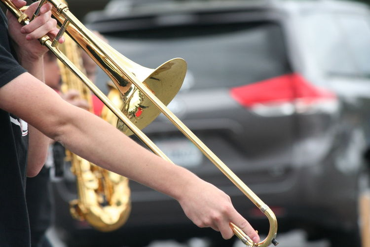 Midsection Of Musician Playing Trumpet During Fourth Of July Parade