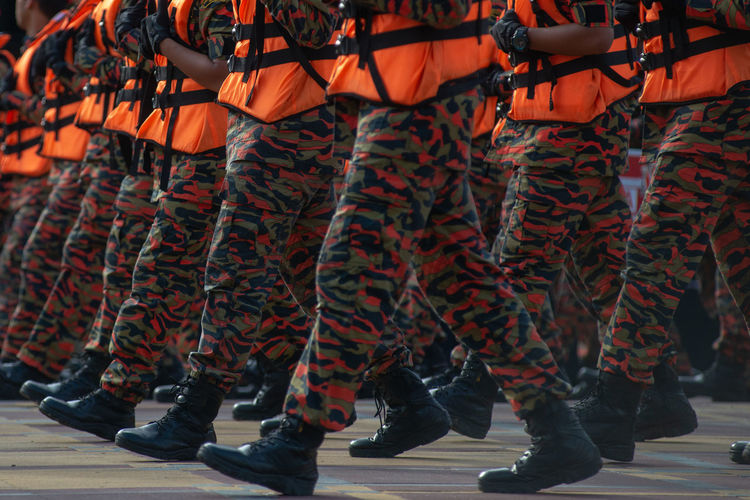 Armed Forces Army Soldier Celebration Clothing Day Firefighters Government Group Of People Human Leg Low Section Medium Group Of People Military Outdoors Parade Performance Real People Shoe Standing Togetherness Uniform