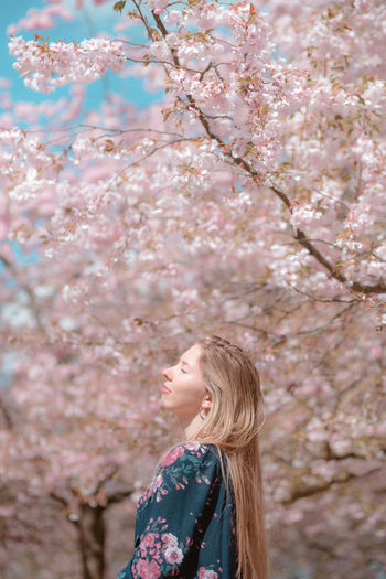 cherry blossoms in København Beauty In Nature Portrait Portrait Of A Woman Portrait Photography Portrait Of A Girl Tree Flower Young Women Women Blond Hair Branch Springtime Beauty Beautiful Woman Side View Cherry Blossom Blossom Cherry Tree In Bloom Orchard