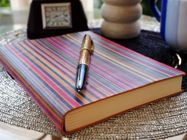 Motivation Lines And Patterns Multi Colored Parallel Lines Golden Pen Writing Instrument Pen Nibs Nib Arrow Symbol EyeEmNewHere Notebook Notebook Cover Old-fashioned Retro Styled Writing Education Knowledge Time To Study Close-up Knowledge Is Freedom Knowledge Is Power Pen Striped Lines, Colors & Textures Notebook Pages