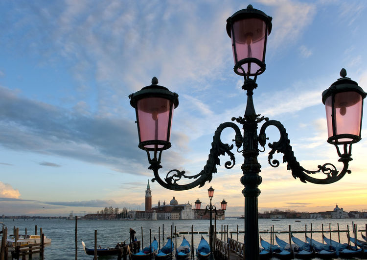 Italy, Venice, Grand Canal, Piazza San Marco, the flood, the Cathedral of San Marco Architecture Building Exterior Built Structure Electric Lamp Electric Light Famous Place In A Row International Landmark Lamp Lamp Post Lighting Equipment Low Angle View No People Outdoors Pole Religion Retro Styled Spirituality Street Light