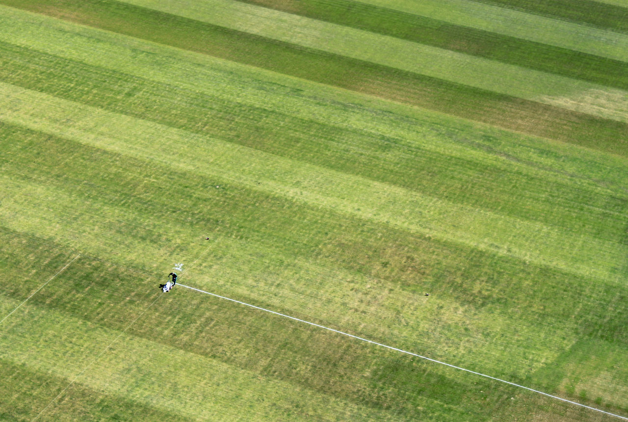 Aerial view of person making yard lines at soccer field
