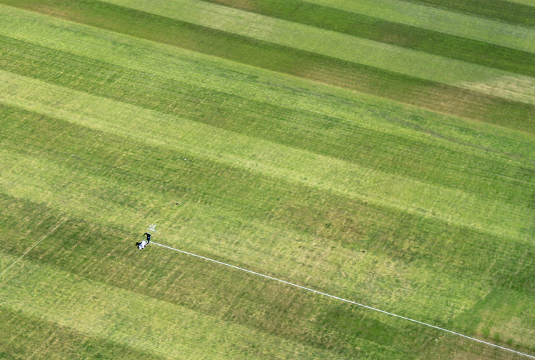 preparations in a football stadium Backgrounds Birds Eye View Europameisterschaft European Championship  Football Football Fever Grass Green Hintergrund Landscape Man At Work Markierung Pattern Preparation  Rasen Sign Soccer Stadium Stripes Everywhere Tranquility Vorbereitung