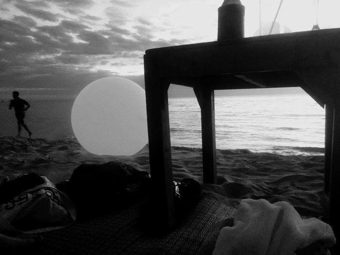 Silhouette people on beach against sky