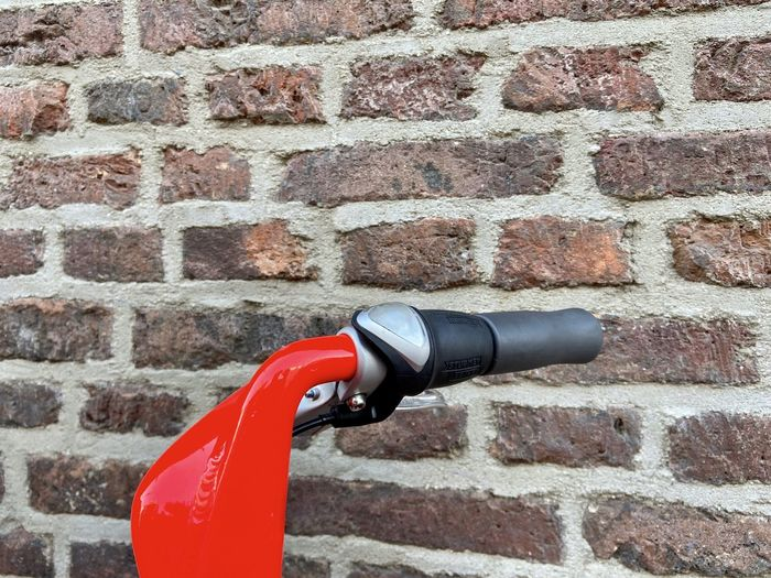 Close-up of fire hydrant against brick wall