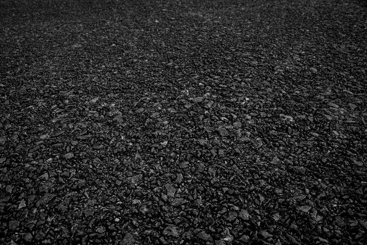 Full frame shot of road on field