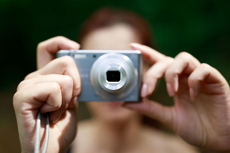 Human Hand Photography Themes Camera - Photographic Equipment Photographing Technology Young Women Paparazzi Photographer Portrait Photographer Holding Lens - Optical Instrument Lens - Eye Camera Digital Camera