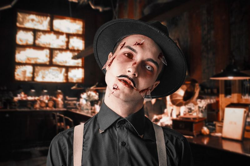Portrait of young man with halloween make-up