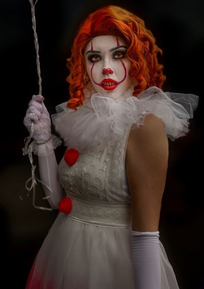 Pennywise Cosplayer Cosplay Nycc2018 NYCC Pennywise One Person Redhead Costume Indoors  Women Three Quarter Length Red Portrait Young Adult Clothing Hairstyle Dyed Red Hair Fashion Make-up