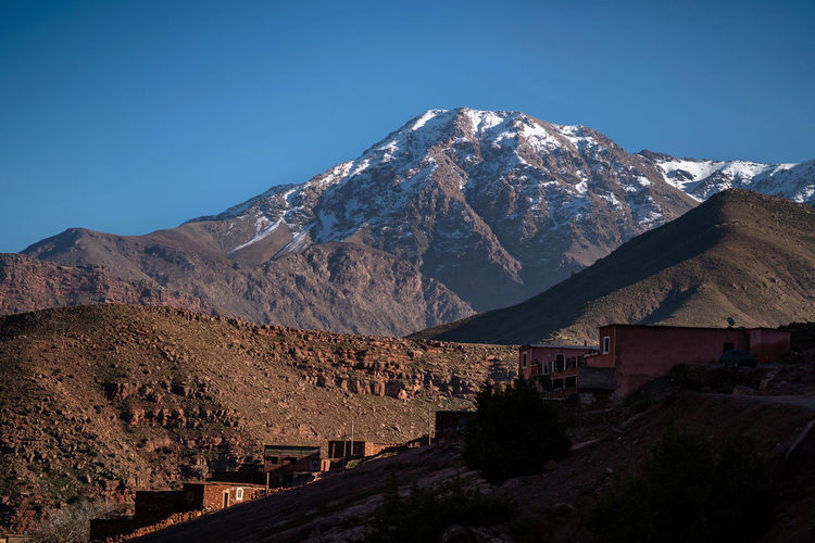 Atlas Mountains Atlas Mountain Marrakech Marrakesh Morocco Travel Destinations Tourist Destination Mountain Range Mountain Mountain View Desert Landscape Desert Desert Beauty Red Mountain Africa Beauty In Nature Building Exterior Built Structure No People Mountain Peak Tranquil Scene Snowcapped Mountain Landscape Snow Nature