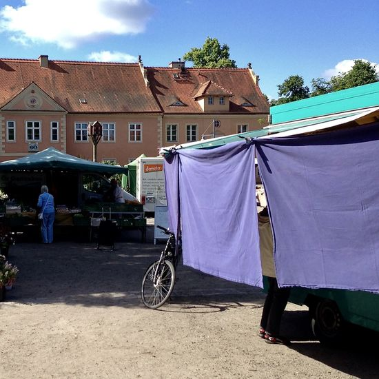 weekly market, domäne dahlem, berlin Agriculture Architecture Bicycle Building Exterior Built Structure Color Drying Food Healty Food Light Light And Shadow Market Outdoors People Retail  Sky Spring Sunlight Sunshine Vegetable Walking Around Weekly Market Canvas Sun Protection Cheese Berlin Love Discover Berlin