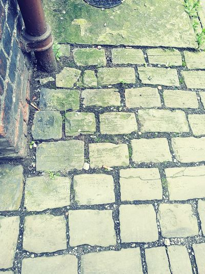 Back Alley Corner Back Of Building Looking Down Paving Stone Cobblestone Cobbles Exposed To The Elements Moss Muck Metal Stones Pebbles Floor Ground Manchester Pattern Textures And Surfaces