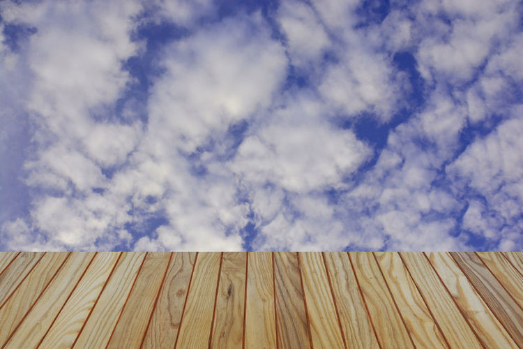 Low angle view of wooden structure against blue sky