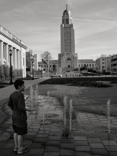 Boy Standing Against Nebraska State Capitol Building