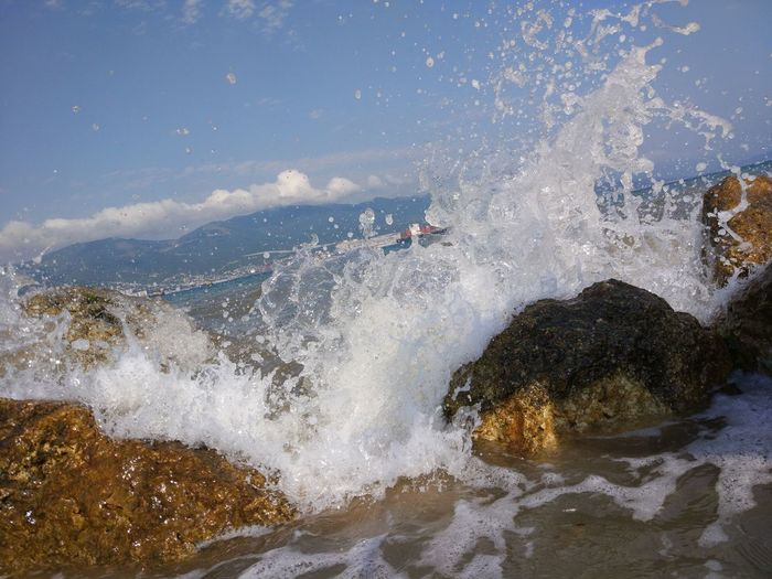 Water Motion Sea Sport Beauty In Nature Nature Rock Splashing Wave Solid Rock - Object Surfing People Aquatic Sport Day Power Outdoors Power In Nature Land Breaking