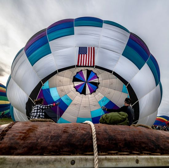 Teamwork Teamwork Hot Air Balloon Built Structure Sky Architecture Shape No People Building Exterior Circle Geometric Shape Low Angle View Close-up Travel Destinations Sphere Outdoors Cloud - Sky