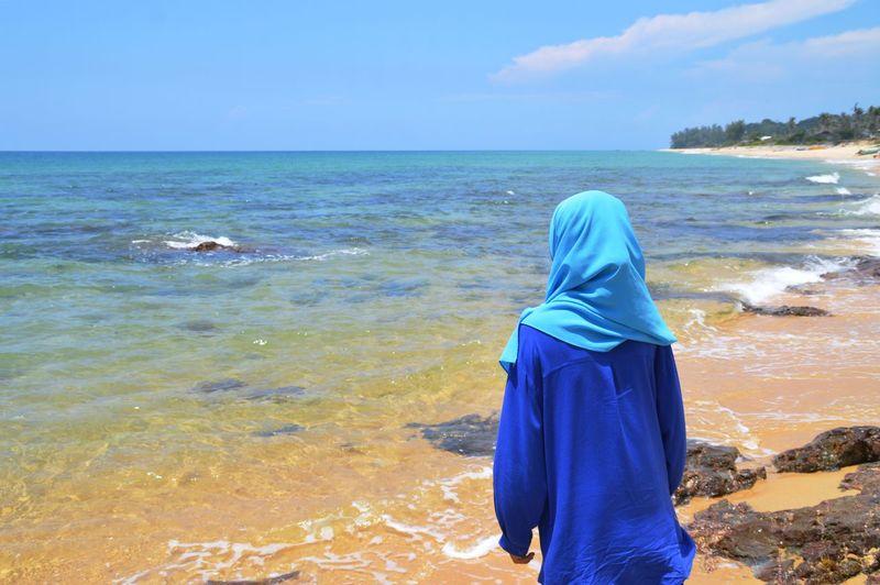 Wearing hijab girl at the beach