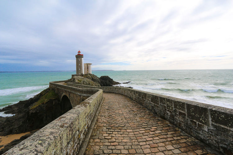 We visited a lot of lighthouses in brittany, but this one is my favourite. A must if you are in this area. Lighthouse_lovers Lighthousephotography Bretagne Phare Du Petit Minou France Water Sand Dune Nautical Equipment Sea Lighthouse Beach Sunset Horizon Direction Sand EyeEmNewHere Coastline Seascape Coastal Feature Coast Horizon Over Water Ocean My Best Travel Photo