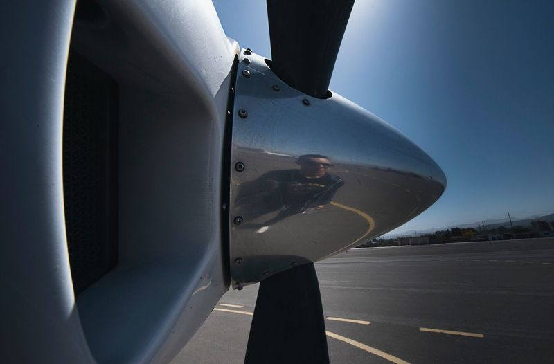 Airplane Transportation Airport Close-up People Of EyeEm Traveling Outdoors Awesome_shots Catch The Moment Nikon Travelphotography Nikonphotography Public Transportation AirPlane ✈ Flight Propeller Flying Airportphotography Travel Photography Reflection Reflection_collection Metal Metallic Screw