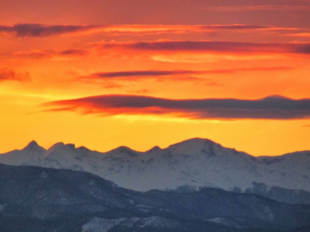 mountain, beauty in nature, nature, scenics, sunset, tranquility, orange color, mountain range, weather, tranquil scene, sky, majestic, outdoors, winter, snow, no people, idyllic, landscape, cold temperature, cloud - sky, silhouette, physical geography, day