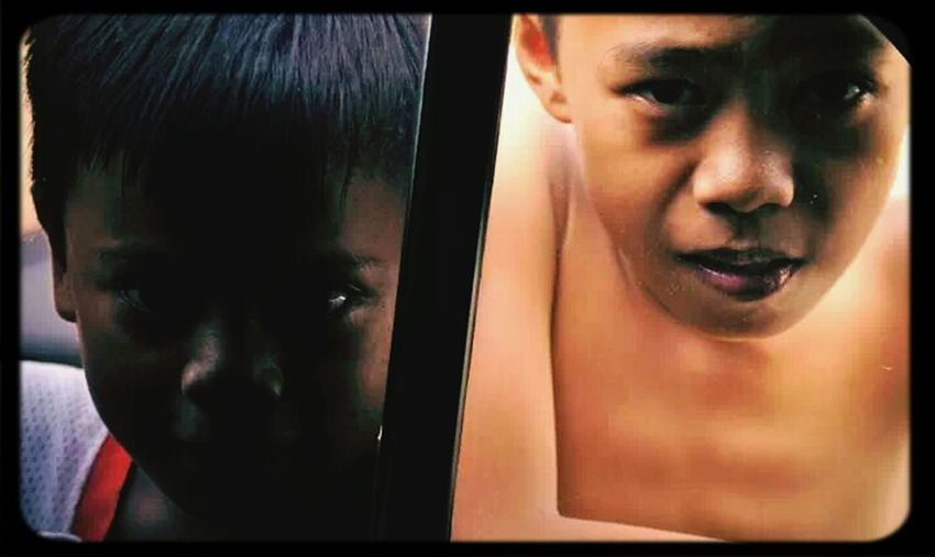 Sitting in the car Street children just are curious, The contrast from the doorwindow gifs a amazing effect. I was going to Southern Leyte for volunteering. here at Cebu there a people living on the street. Visual Statements Your Photo For Social Change By PhotoPhilanthropy