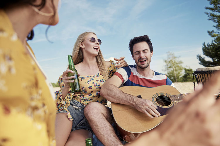 Young couple holding guitar