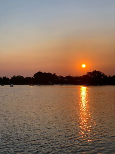 Sunset with Water Sunset Sky Scenics - Nature Beauty In Nature Reflection Tranquility Waterfront Orange Color Tranquil Scene Sun Lake Nature Sunlight Outdoors Romantic Sky