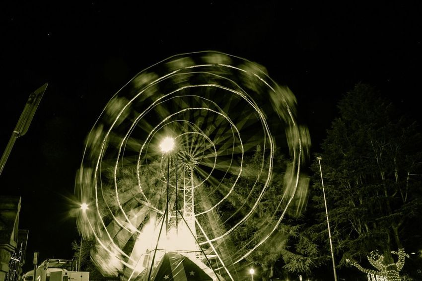 Artistic Warp Speed Spinning Wheel Light Up Your Life Christmas In July Bathurst Winterfest Light In The Darkness Fun Illumination School Holidays Australian Photographers Black And White Collection  Night Illuminated No People Low Angle View Arts Culture And Entertainment Glowing Sky Pattern Geometric Shape Circle Lighting Equipment Shape Light Outdoors Spinning Long Exposure Blurred Motion Motion