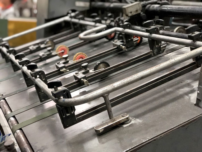 Arts Culture And Entertainment Close-up Competition Control Equipment Factory Focus On Foreground High Angle View In A Row Indoors  Industry Leisure Activity Leisure Games Machinery Male Likeness Metal Music No People Pipe - Tube Technology