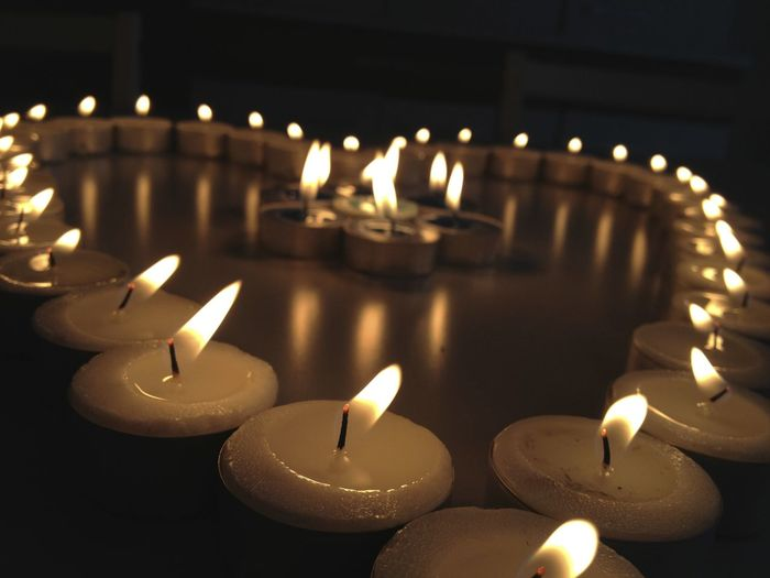 Close-Up Of Lit Candles In Formation