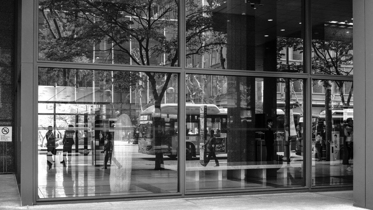 Reflection Of People On Glass Window