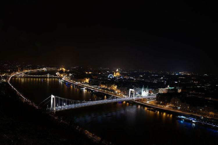 High angle view of illuminated bridge in city at night