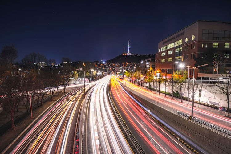 Seoul city of light trails traffic speeds through an intersction road in seoul Korea. Architecture Bridge; Speed; Background; Scene; River; Han; Urban; Transportation; Business; Korean; Bus; Downtown; Building Exterior Built Structure City City Street Cityscape District; Aerial; Motion; Asia; Landmark; Blur; Metropolis; Dongjak; Modern; Life; High; Asian; Tower; Lake High Angle View Illuminated Light Trail Long Exposure Motion Nature Night Outdoors Road Seoul; Light; Car; Night; Korea; City; Traffic; View; South; Trails; Road; Street; Skyline; Cityscape; Travel; Speed Street Light Transportation Vehicle Light
