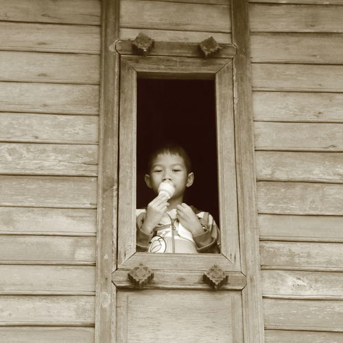 Asian Boy Boy Childhood Close-up Cute Day Indoors  Innocence Monochrome One Boy One Person People Real People Sepia Photography Wood - Material