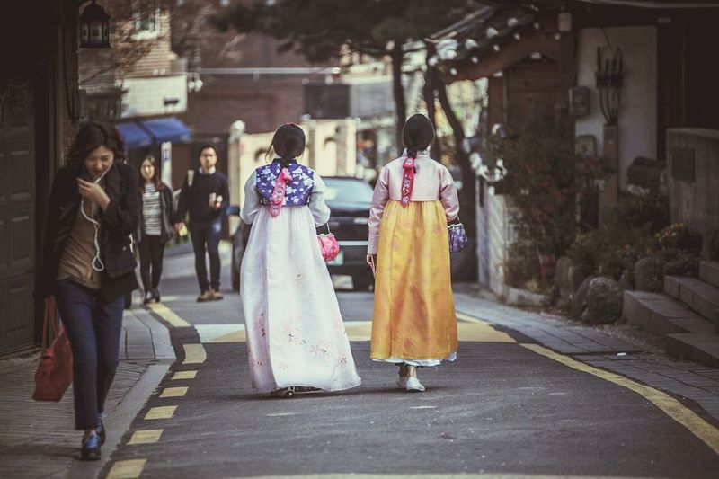 Teen Girls Traditional Costume Teen Girls With Korean Traditional Clothes Hanbok Street Photography Back Walking Girls Seoul, Korea Take A Walk