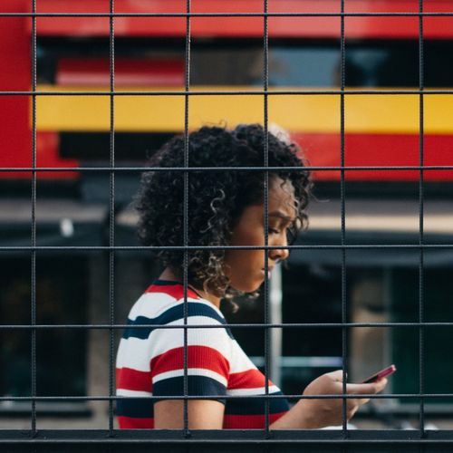 Urban Geometry Frame Colorful Urban City Citylife Street Streetphotography One Person Curly Hair Offspring Girls Portrait Looking Casual Clothing Real People Women Leisure Activity Hairstyle Outdoors