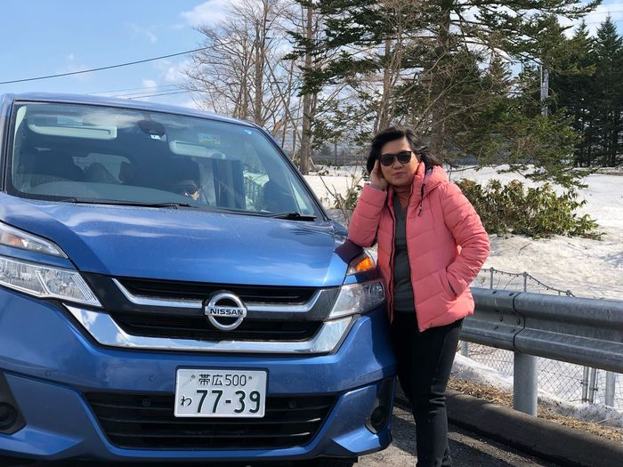 Hokkaido self-drive by car rental from Nippon rent a car EyeEm Selects One Person Mode Of Transportation Standing Real People Car Young Adult Outdoors Looking At Camera Portrait Leisure Activity Young Men Full Length Nature Front View Casual Clothing Clothing Motor Vehicle Transportation Day Lifestyles