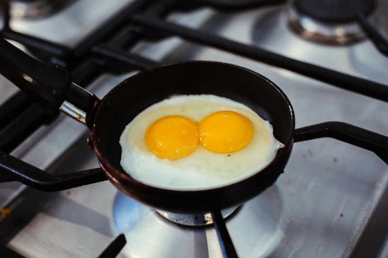 Stove Food Pan Food And Drink Kitchen Utensil Cooking Pan Frying Pan Appliance Preparation  Burner - Stove Top Egg Household Equipment Freshness Healthy Eating Indoors  Fried Kitchen Egg Yolk Preparing Food Fried Egg No People Breakfast Sunny Side Up Gas Stove Burner Meal