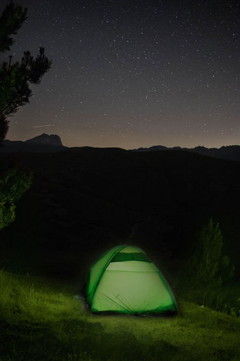 Tent on field against sky at night