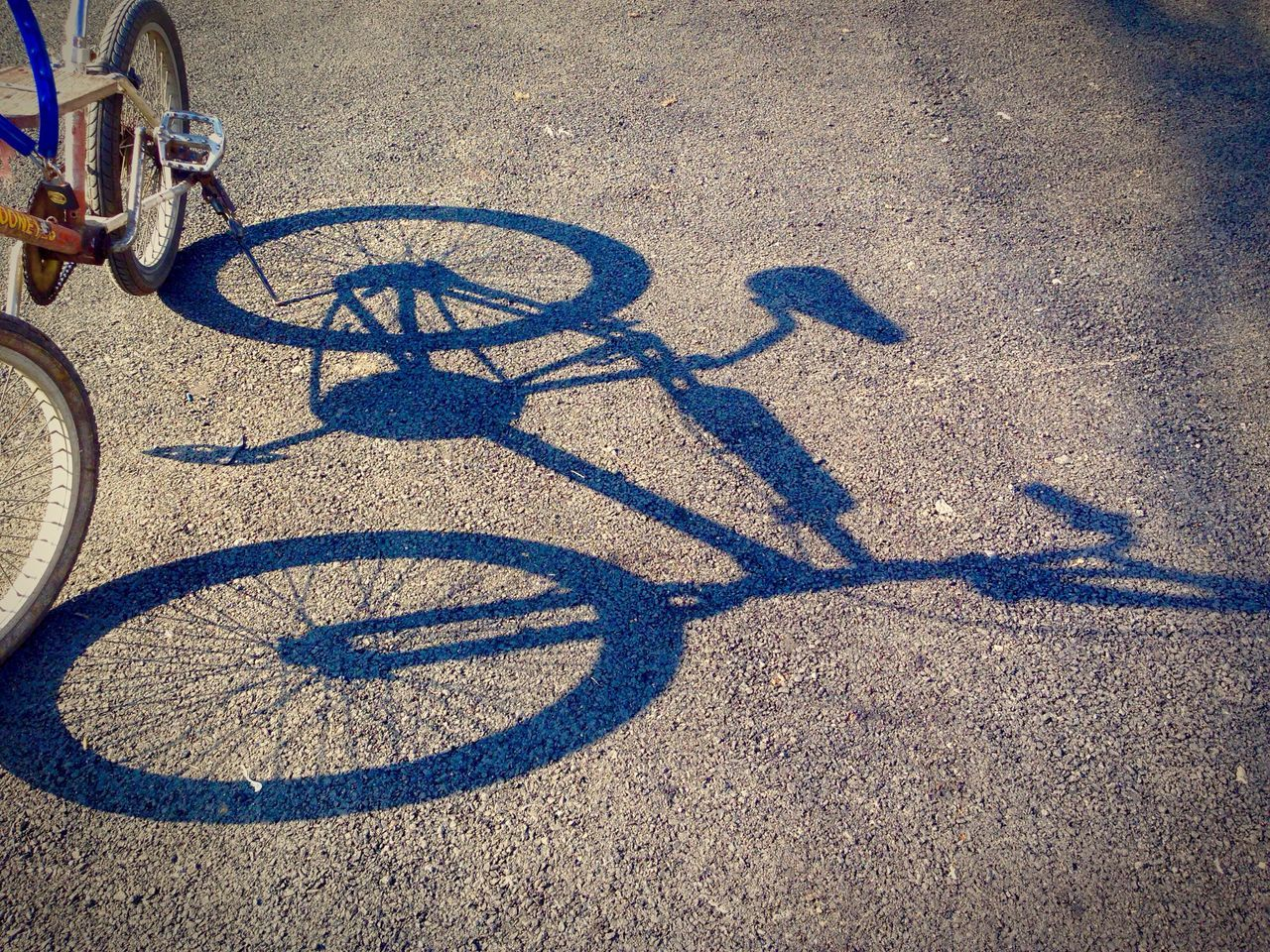 bicycle, transportation, outdoors, shadow, day, high angle view, street, no people, road, sunlight