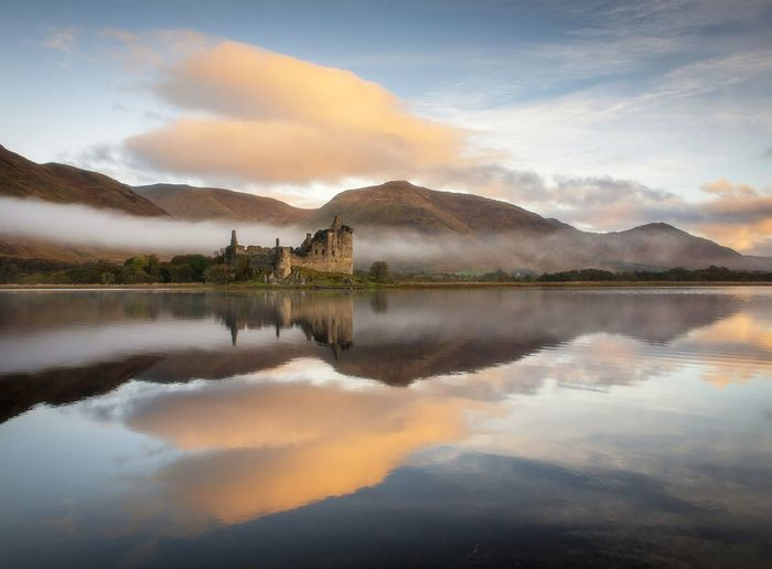 Kilchurn Castle, Loch Awe Castle Ruins History Building Scotland Reflection Reflection_collection Sunrise Sunlight Nikon Bestoftheday Reflection Lake Sky Sunset Water Cloud - Sky Nature Landscape Tree No People Outdoors Reflection Lake Scenics Day