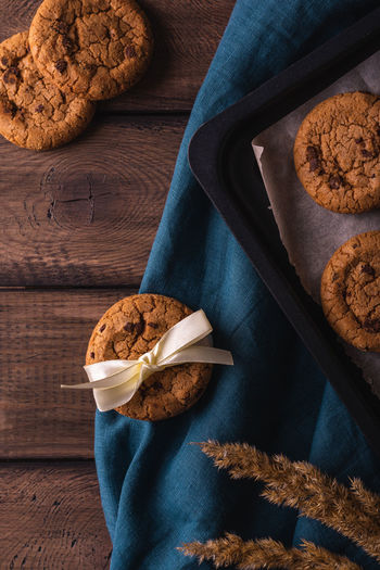 Chocolate cookies on a wooden table decorated with a blue napkin