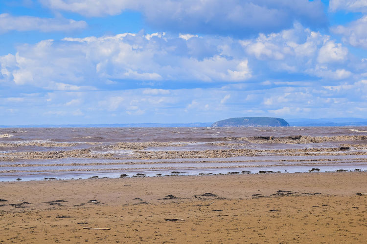 Land Beach Sky Sand Scenics - Nature Nature Beauty In Nature Tranquil Scene Day Beach Photography Space For Text Space For Copy Blue Sky Cloud - Sky Water Tranquility Sea Non-urban Scene No People Environment Landscape Outdoors Remote Arid Climate Climate Horizon Over Water Steep Holm