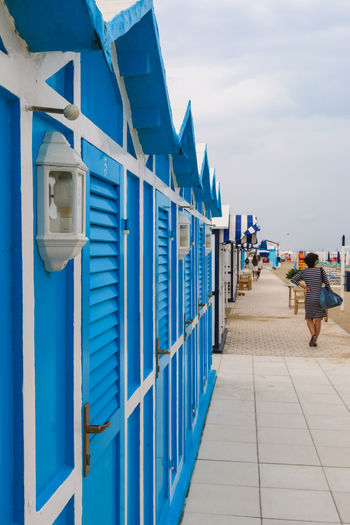 Blue beach cabins along the beach, Italy, Riccione Italy. Riccione Rimini Vacations Beach Beach Cabins Blue Day Footpath Italy Outdoors Resort Riccione Sky Walking
